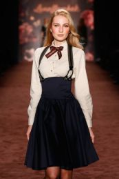 A model walks the runway at the Lena Hoschek show during the Mercedes-Benz Fashion Week Berlin Autumn/Winter 2016 at Brandenburg Gate on January 19, 2016 in Berlin, Germany.