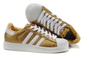Tenis dourado Adidas